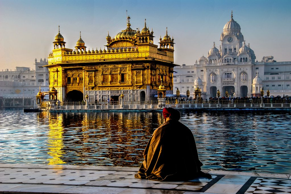 Old Man sitting at Golden Temple in Winters