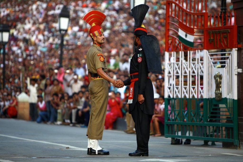 Guards shaking hands at Wagah Border Closing Ceremony